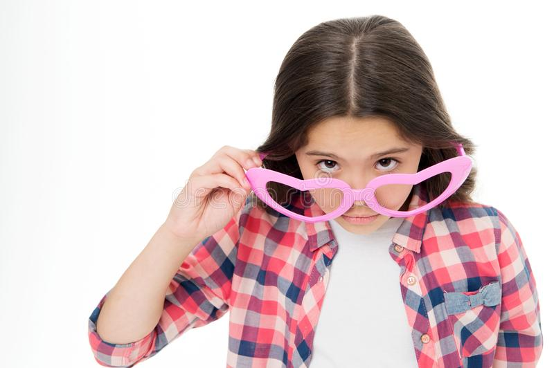 Girl cute big heart shaped glasses isolated white background. Child girl looks wondered or surprised. Are you serious royalty free stock photography