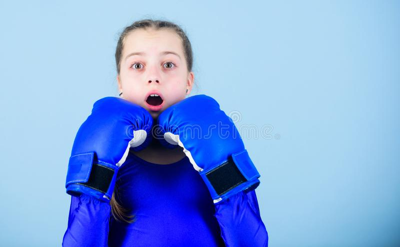Girl cute boxer on blue background. With great power comes great responsibility. Boxer child in boxing gloves. Female. Boxer change attitudes within sport. Risk royalty free stock image