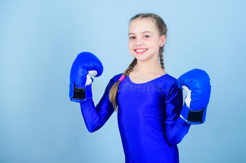 Girl cute boxer on blue background. Rise of women boxers. Female boxer change attitudes within sport. Feminism concept. With great power comes great stock photos