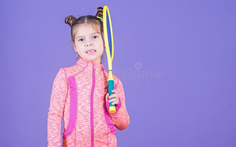 Girl cute child double bun hairstyle tennis player. Childhood and active games. Sport upbringing. Small cutie likes stock image