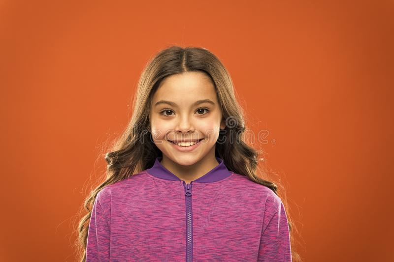 Girl cute child happy smiling face. Child long hair happy smiling. Happy childhood concept. What science has to say royalty free stock photos