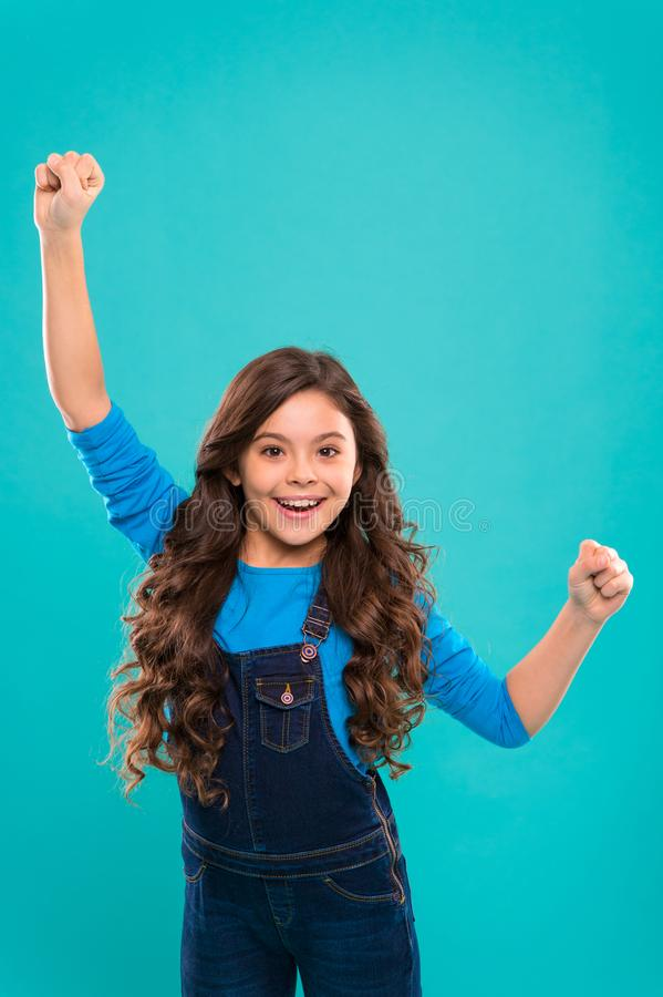 Girl cute child long curly hair happy smiling. Child psychology and development. Happy winner. Celebrate victory or stock images