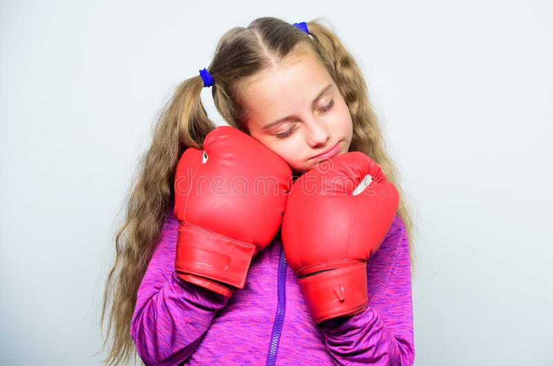 Girl cute child with red gloves posing on white background. Sport upbringing. Upbringing for leader. Strong child boxing. Sport and health concept. Boxing royalty free stock photo