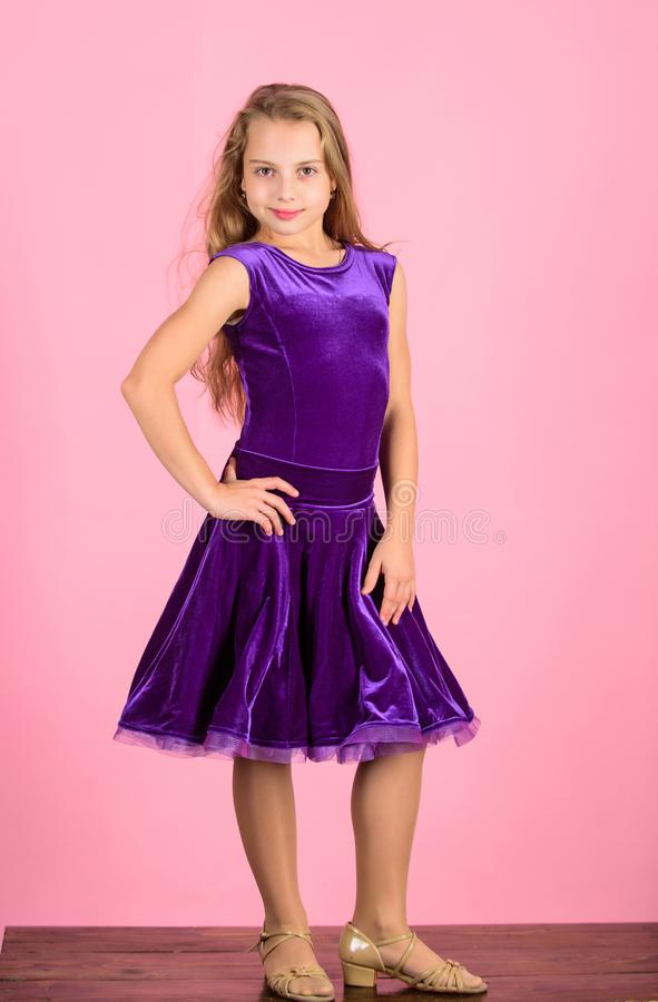 Girl cute child wear velvet violet dress. Clothes for ballroom dance. Ballroom dancewear fashion concept. Kid dancer royalty free stock photo