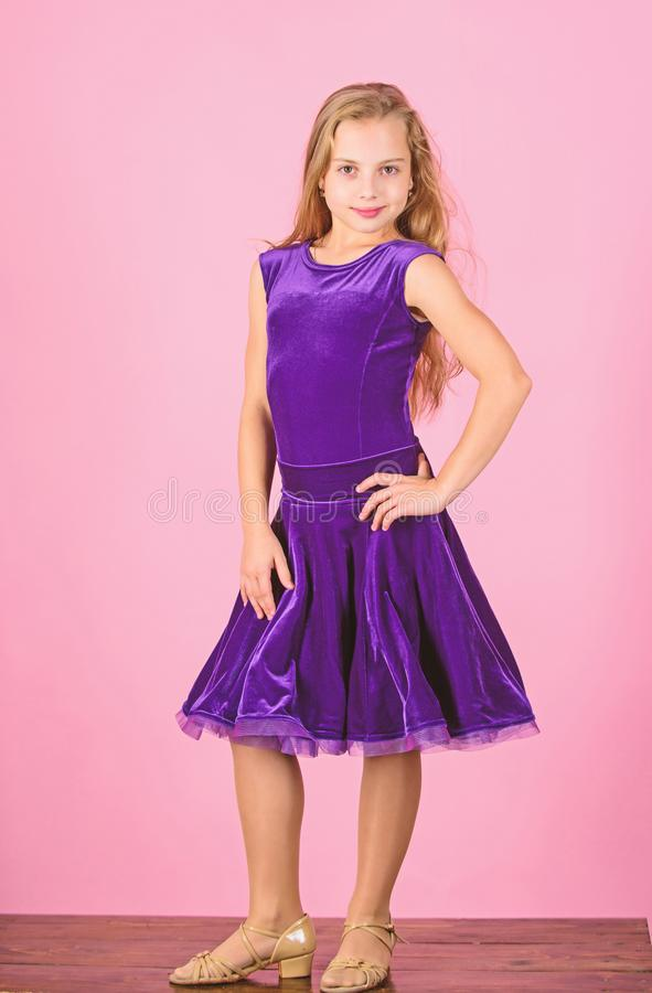Girl cute child wear velvet violet dress. Clothes for ballroom dance. Ballroom dancewear fashion concept. Kid dancer. Satisfied with concert outfit. Kids stock images