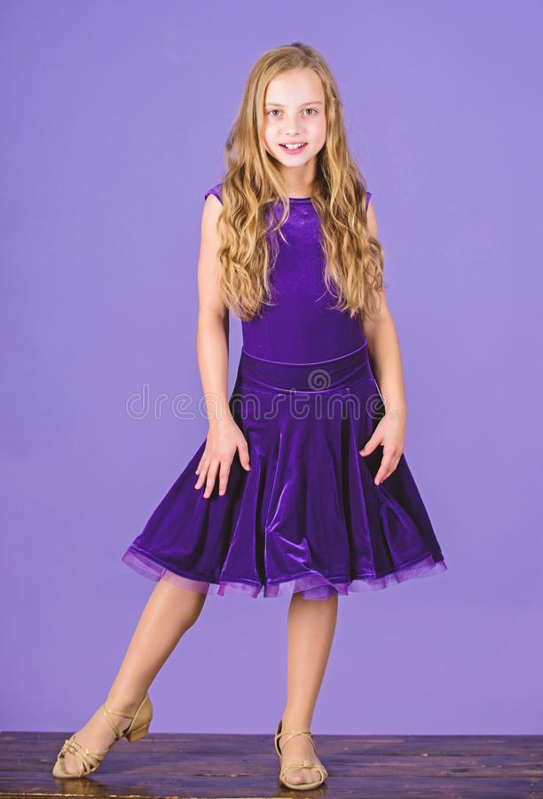 Girl cute child wear velvet violet dress. Clothes for ballroom dance. Kid fashionable dress looks adorable. Ballroom. Dancewear fashion concept. Kid dancer royalty free stock photos