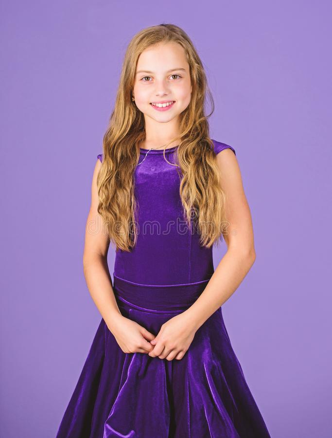 Girl cute child wear velvet violet dress. Clothes for ballroom dance. Kids fashion. Kid fashionable dress looks adorable. Ballroom dancewear fashion concept stock photography