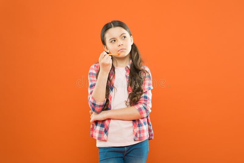 Girl cute having fresh idea. Write essay or notes. Calligraphy classes. Inspiration for study. Back to school. Start royalty free stock photography