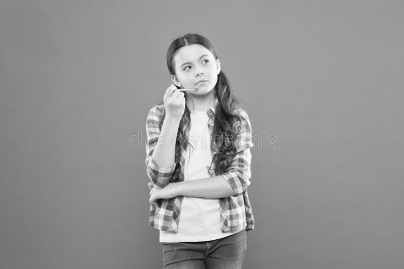 Girl cute having fresh idea. Write essay or notes. Calligraphy classes. Inspiration for study. Back to school. Start royalty free stock images