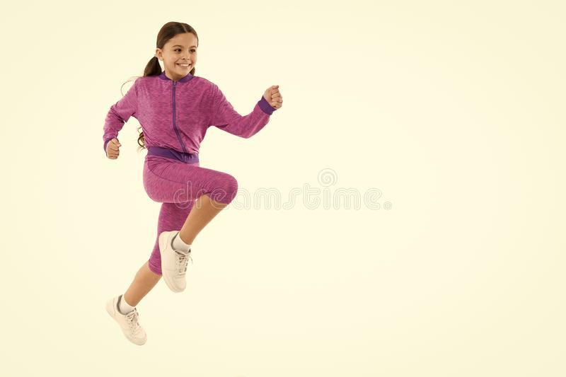 Girl cute kid with long ponytails sportive costume jump isolated on white. Working out with long hair. Sport for girls. Guidance on working out with long hair royalty free stock photography