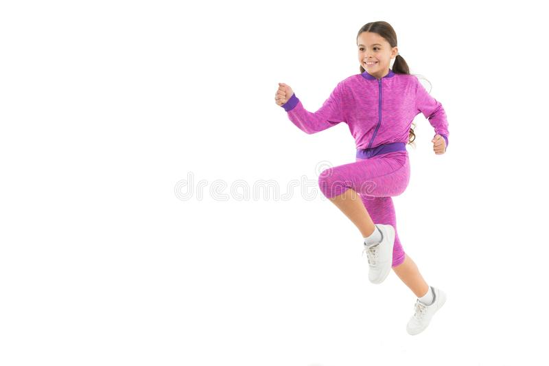 Girl cute kid with long ponytails sportive costume jump isolated on white. Working out with long hair. Sport for girls. Guidance on working out with long hair stock photo
