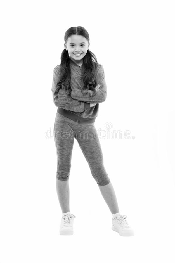 Girl cute kid with long ponytails wear sportive costume isolated on white. Sport for girls. Guidance on working out with. Long hair. Deal with long hair while royalty free stock photos