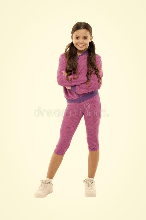 Girl cute kid with long ponytails wear sportive costume  on white. Sport for girls. Guidance on working out with. Long hair. Deal with long hair while stock image
