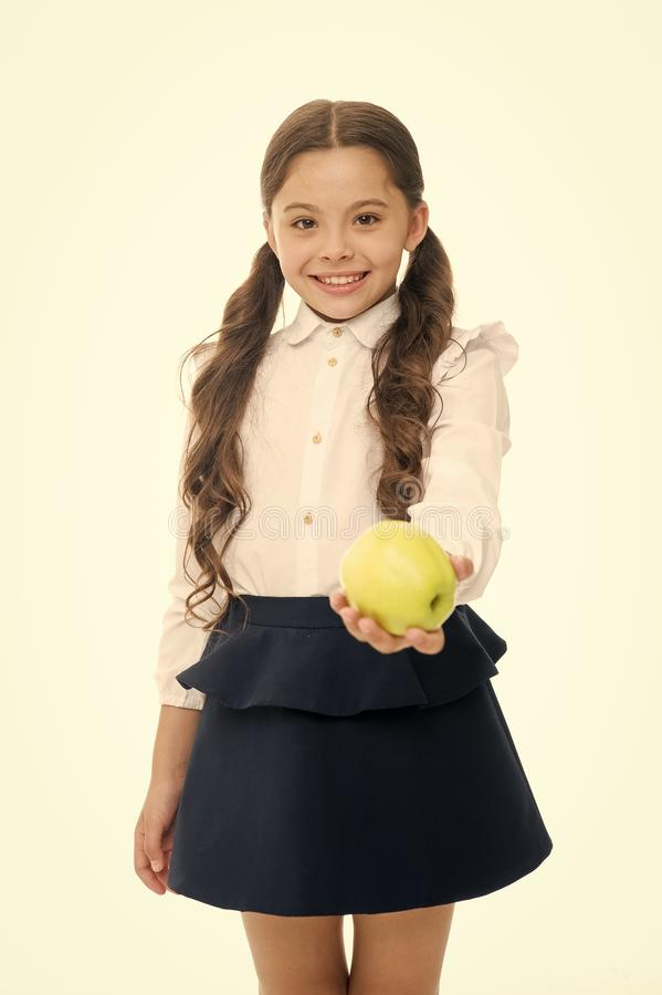 Girl cute pupil hold apple fruit stand on white background. Kid happy hold apple. School snack concept. Healthy. Nutrition diet. Apple vitamin snack. Child stock photo