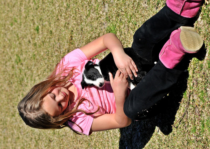 Girl with cute puppy stock image