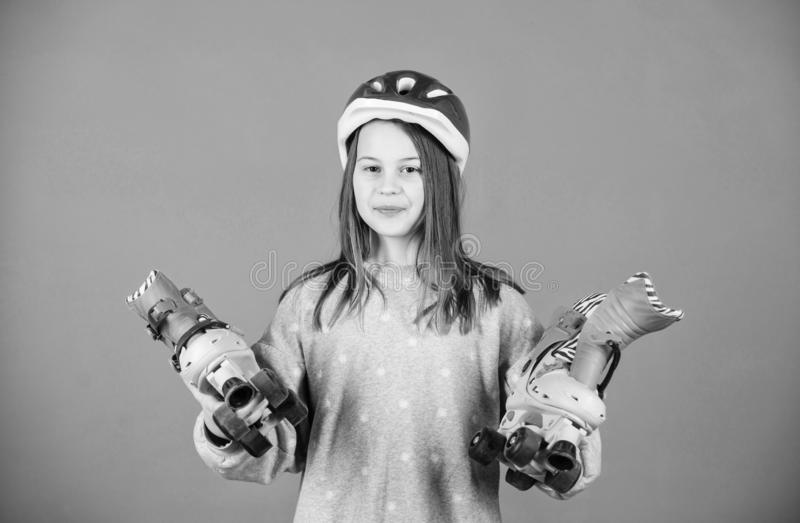 Girl cute teen wear helmet and roller skates on violet background. Active leisure and lifestyle. Roller skating teen. Hobby. Joyful teen going to ride. Sporty stock photos