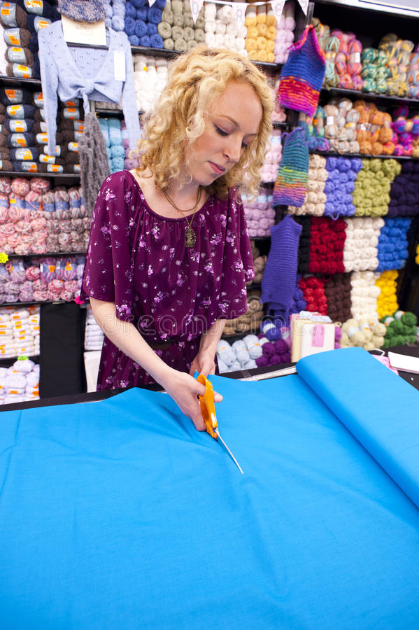 Download Girl cutting fabric 2 stock photo. Image of concentrating - 26561538