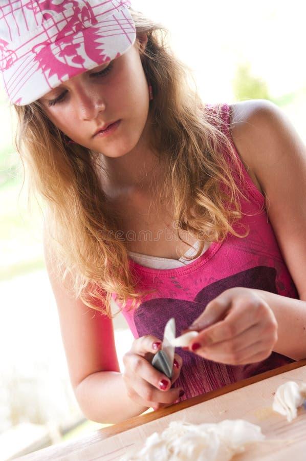 Girl cutting garlic