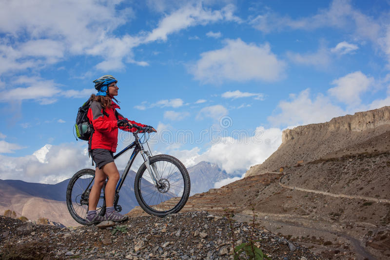Girl cycling at the road royalty free stock photography
