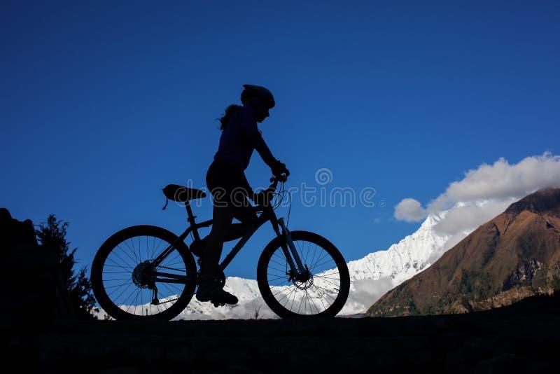 Girl cycling at the road royalty free stock image