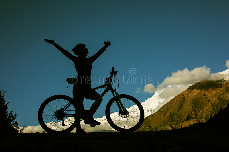 Girl cycling at the road stock images