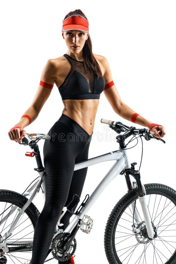 Girl cyclist with bicycle in silhouette on white background. stock photos