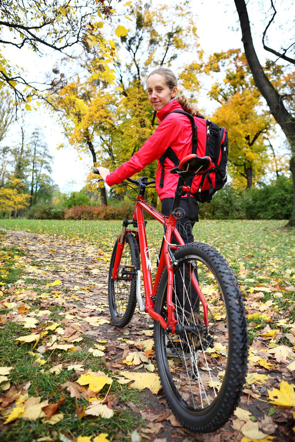 Download Girl Cyclist With Bike On Bicycle Walk In Autumn Park Stock Image - Image: 33472941
