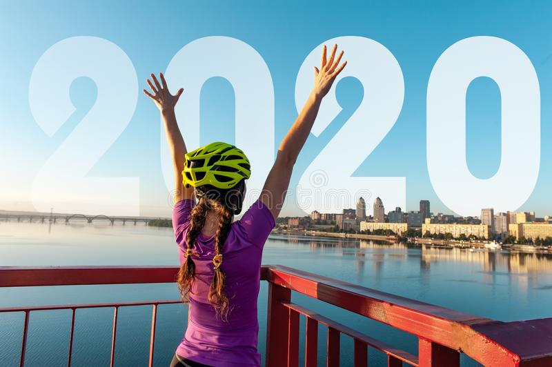 Girl cyclist in a helmet at the finish royalty free stock images