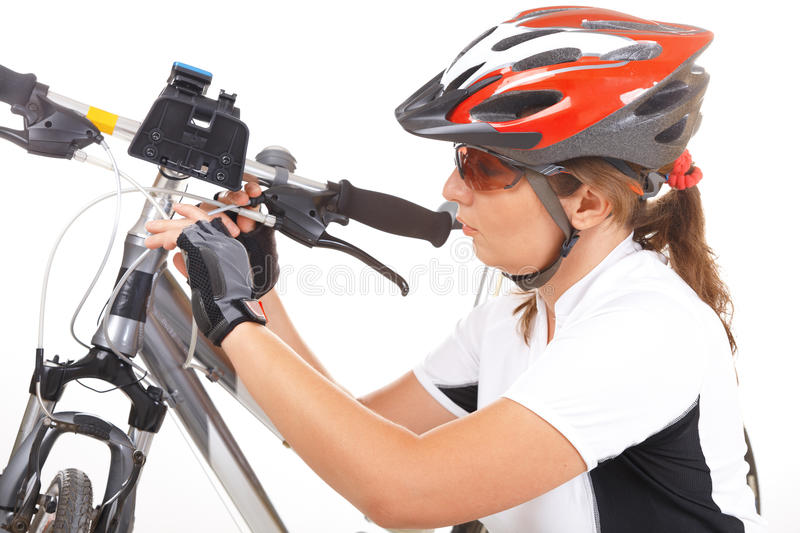Girl Cyclist repair her bike royalty free stock photo