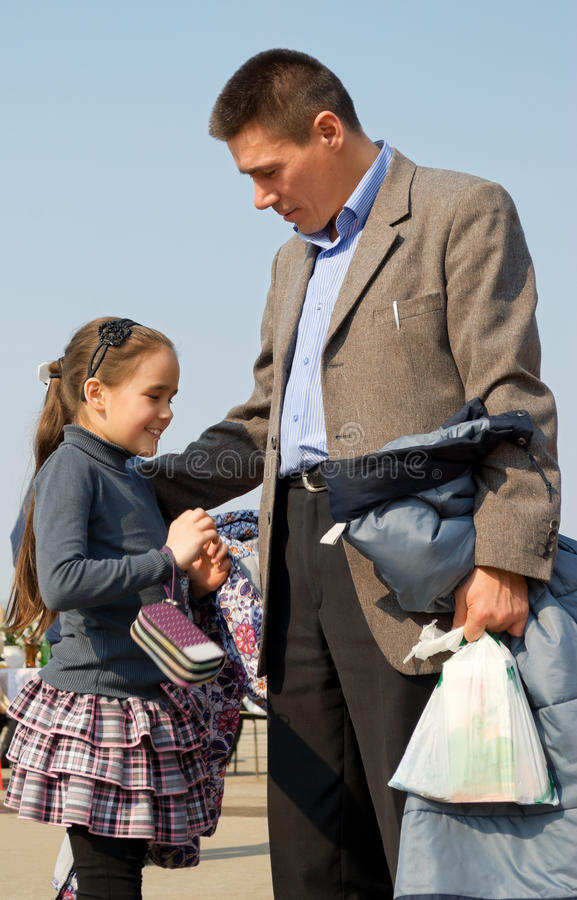 Girl and dad. Father and daughter walking in the spring the city