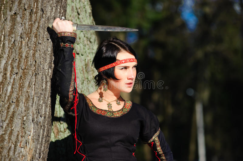 The Girl With A Dagger Royalty Free Stock Images
