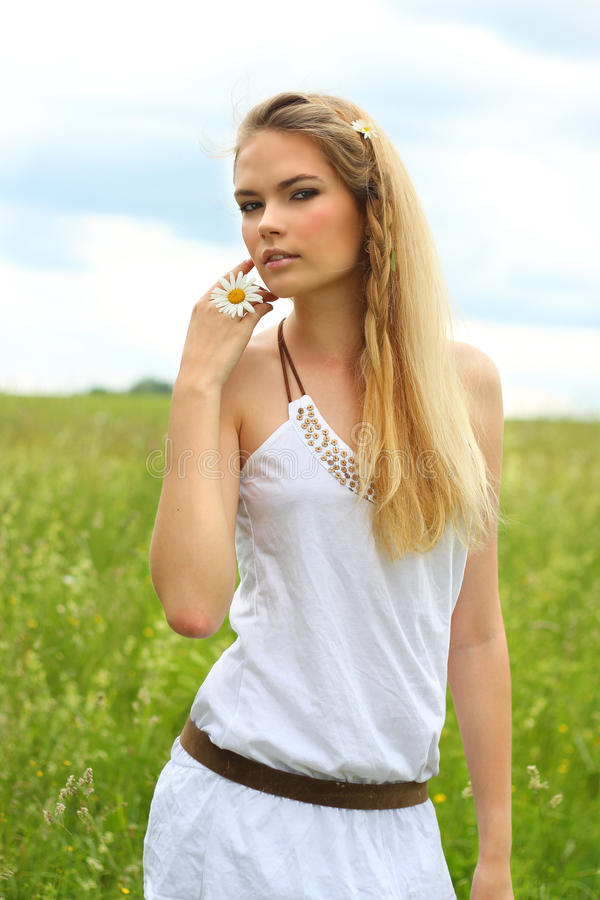Download Girl With Daisies In Her Hand Stock Photo - Image of blonde, freedom: 24237992