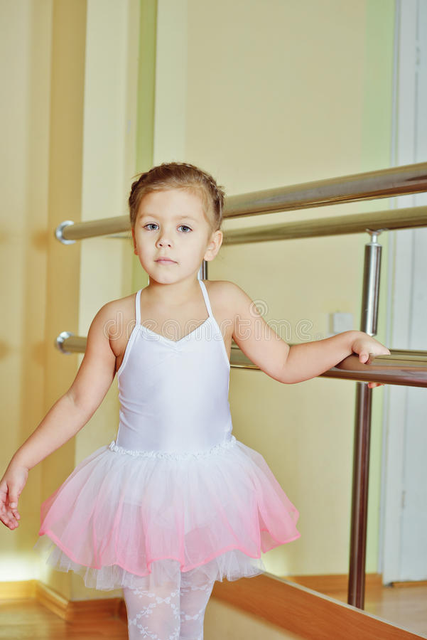Girl in dance school. Sweet little girl in dance school studio royalty free stock images