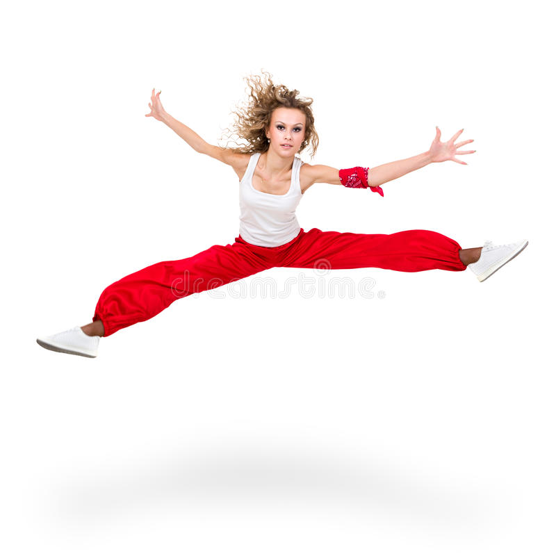 Girl dancer jumping. Modern teenage girl dancer jumping against isolated on a white background royalty free stock images