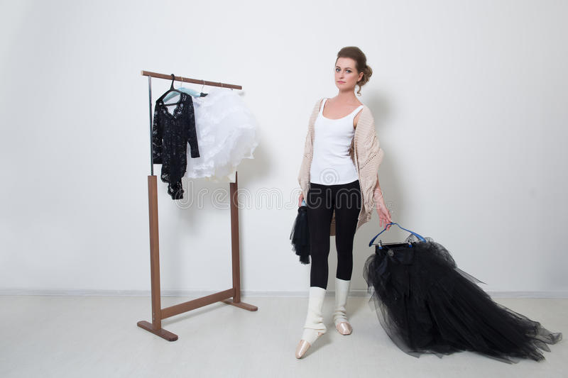 Girl dancer before Training. Choose Your clothes. stock photography