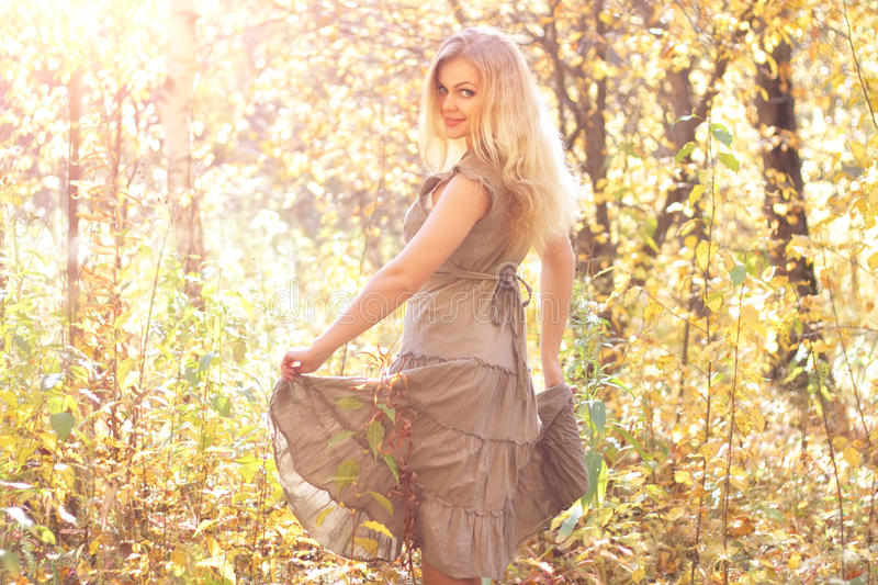Girl dances in the autumn forest royalty free stock image