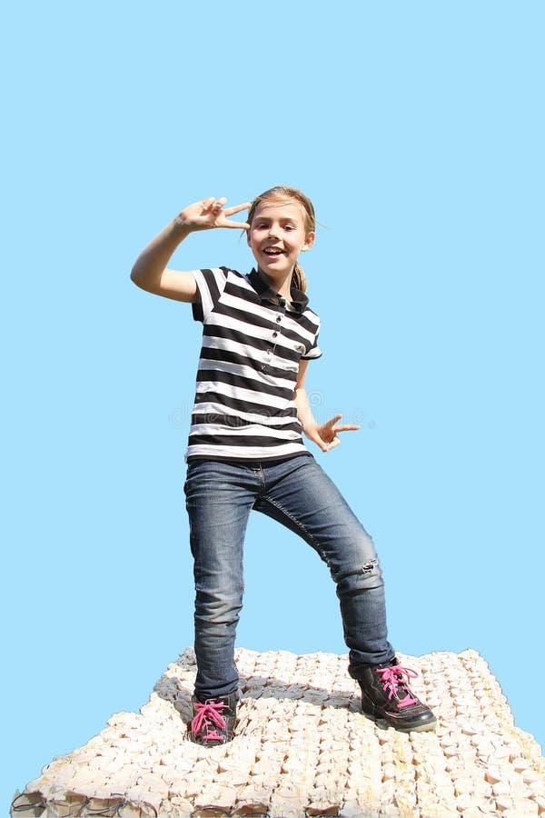 Girl dancing on a mattress stock photo