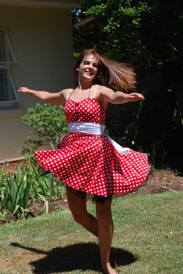 Girl dancing outdoors stock photos
