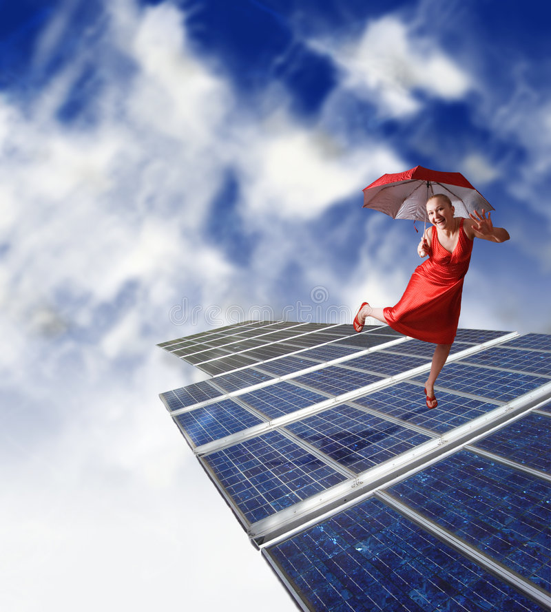 Girl dancing on solar panels. Happy smiling girl dancing on solar panels