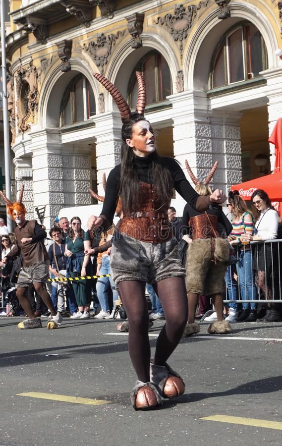 Girl dancing on the street masked in the god Pan on the carnival celebration day stock image