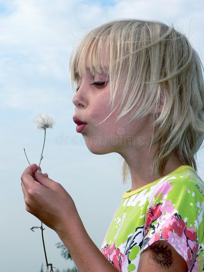 Download The girl and a dandelion stock image. Image of summer - 1191963