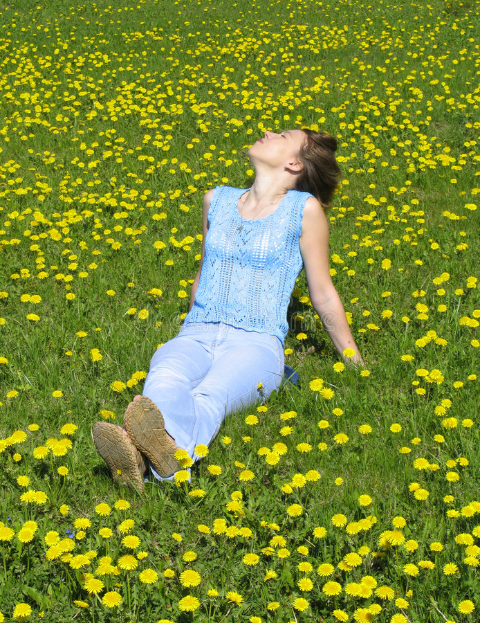 Girl on dandelion lawn stock images