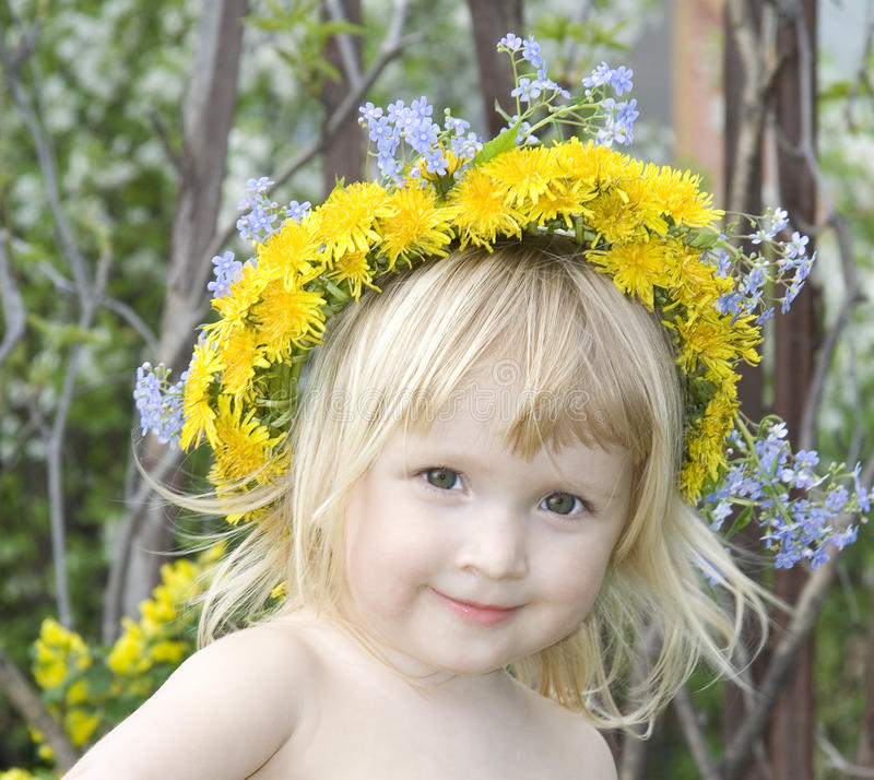 Girl with dandelion`s diadem royalty free stock image