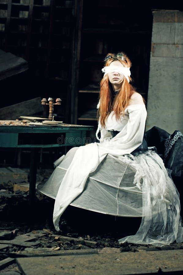 Girl in dark room stock images