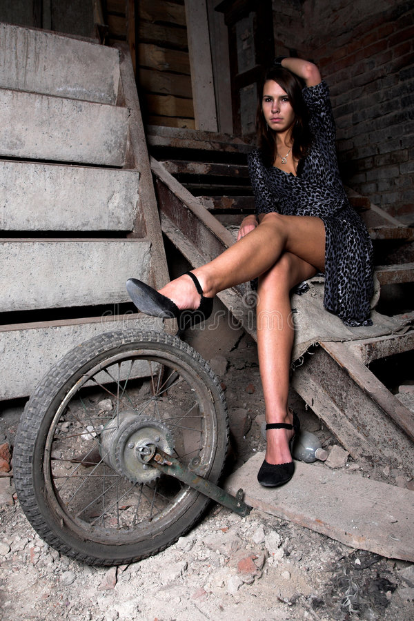 Girl on the dark stairs royalty free stock photo