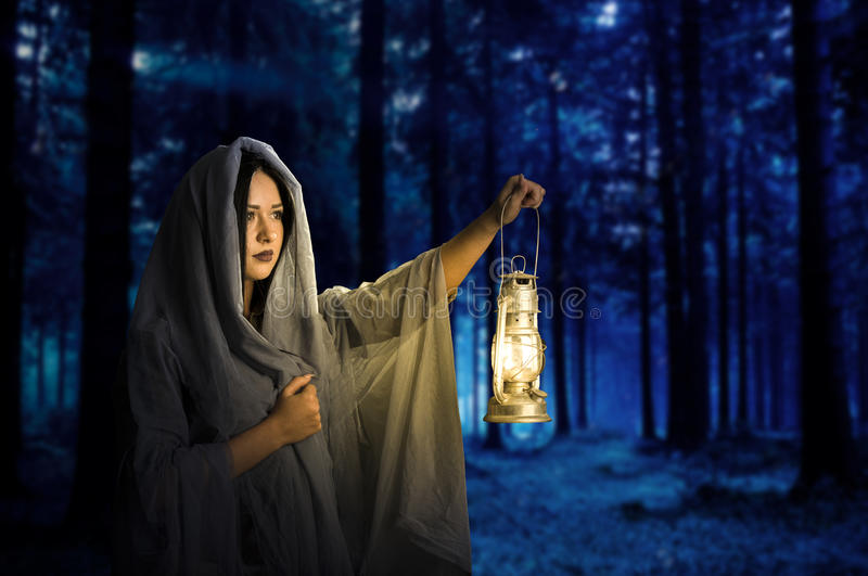 The girl in the dark woods royalty free stock photos