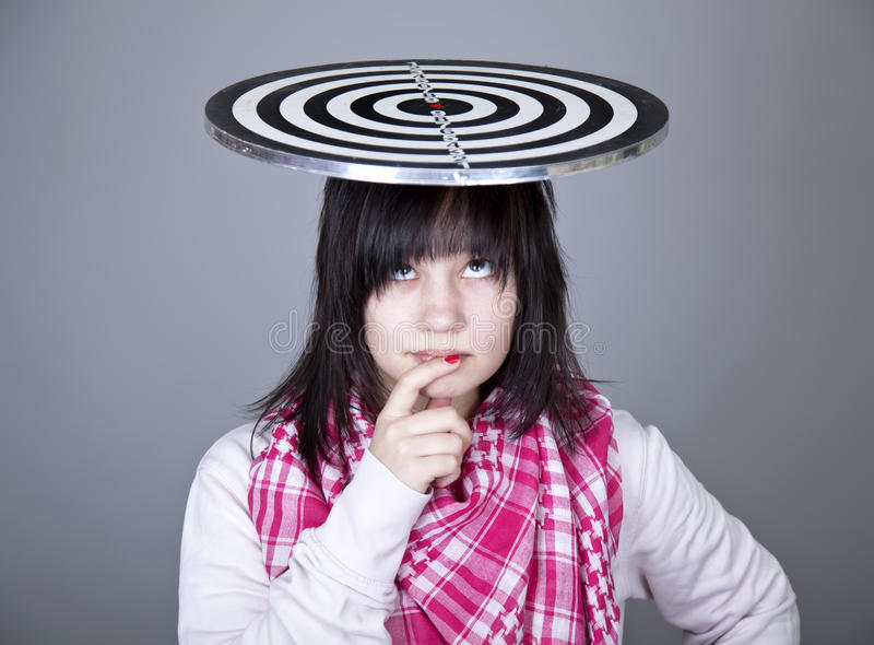 Girl with darts. Studio shot stock image