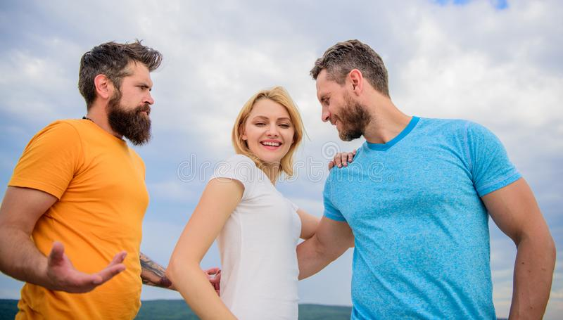 Girl decided with whom dating. Girl stand between two men. Couple and rejected partner. Woman picked boyfriend. Love as. Competition concept. Start romantic royalty free stock photo