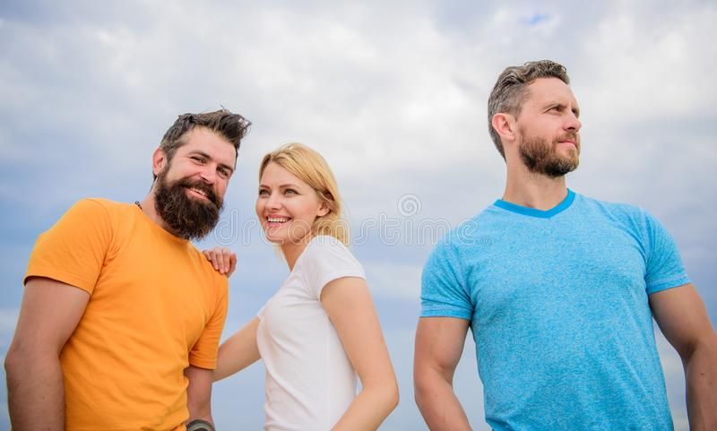 Girl decided with whom dating. Girl stand between two men. Couple and rejected partner. Woman picked boyfriend. Love as. Competition concept. She made her stock image