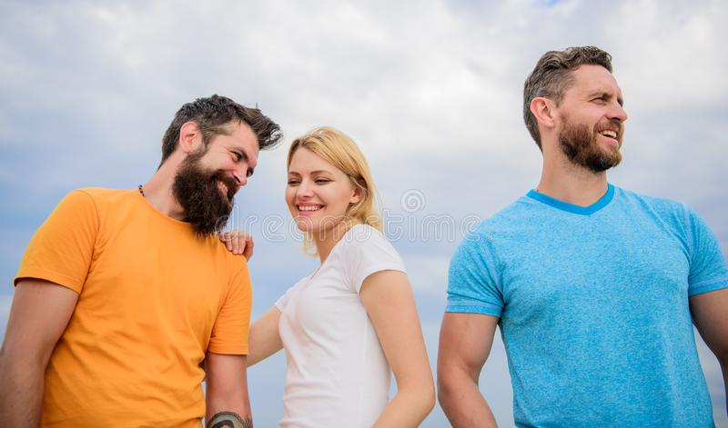 Girl decided with whom dating. Start romantic relationships. Girl stand between two men. Couple and rejected partner. Woman picked boyfriend. Love as royalty free stock photography